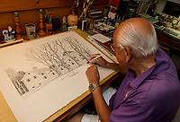 Roger Gagne of the Lakes Region Art Association works on his drawing of the Hathoway House in his home studio on Thursday morning.  (Karen Bobotas/for the Laconia Daily Sun)