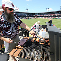 Chad Dacus, of Starkville and a Mississippi State Alumni, cooks on his grill preparing lunch at his center field seats prior to the start of the 2019 NCAA Starkville Regional on Friday afternoon where Mississippi State hosted Southen.