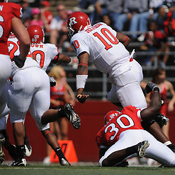 Apr 18, 2009; Piscataway, NJ, USA; Rutgers QB D.C. Jefferson breaks the attempted tackle of Edmond Laryea (30) during the second half of Rutgers' Scarlet and White spring football scrimmage.