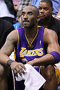 Los Angeles Lakers guard Kobe Bryant looks on from the bench as the final seconds count down during the second half of an NBA basketball game again st the Utah Jazz, Saturday, Feb. 4, 2012, in Salt Lake City. The Jazz beat the Lakers 96-87. (AP Photo/Colin E Braley).