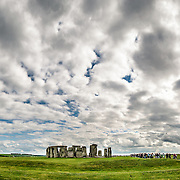 Stonehenge Panorama with Dramatic Clouds. Believed to have been built somewhere between 2000 and 3000 BC, Stonehenge is one of the United Kingdom's most distinctive landmarks. It's function and purpose remains a matter of conjecture, although many theories have been offered. It consists of a series of large standing stones, some of which have toppled over the centuries. Stonehenge is located in Salisbury Plain west of London.