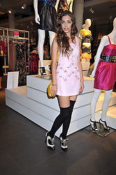 AMBER LE BON at a party to celebrate the launch of the Matthew Williamson collection at H&M held at the H&M store, Regent Street, London on 22nd April 2009.