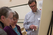 From left to right, Betty Hollow, Dianne Bouvier, and Paul Logue, the city planner in the Park Place Strategy Work Group, look at one of the boards at the public planning workshop at the Athens Community Center on Feb. 22, 2017.