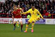 MK Dons forward Rob Hall and Nottingham Forest midfielder Ben Osborn challenge for the ball during the Sky Bet Championship match between Nottingham Forest and Milton Keynes Dons at the City Ground, Nottingham, England on 19 December 2015. Photo by Aaron Lupton.