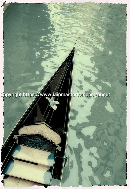Toned image of gondola on canal in Venice Italy