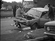 Bomb Attack On Dr Jim Donovan.  (P8)..1982..06.01.1982..01.06.1982..6th January 1982..This morning Dr Jim Donovan, Senior Forensic Scientist with the Garda Technical Bureau, was critically injured when a bomb planted in his car exploded. Due to his ongoing investigative work, it is suspected that there may be an IRA or Dublin criminal gang involvement in the attack...Image shows the devastation to the car which was being driven by Dr Donovan when the bomb exploded. The car is being examined by members of the Garda Technical Squad.