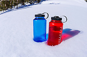 Water bottles on snow, John Muir Wilderness, Sierra Nevada Mountains, California  USA
