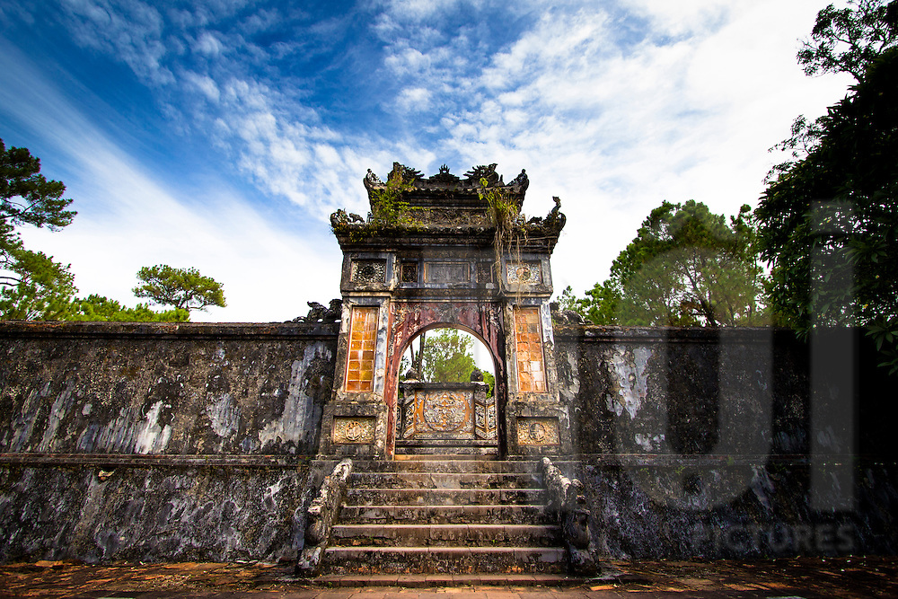An old mossy arch gate inside Tu Duc tomb area. Tu Duc tomb, Thua Thien Hue, Vietnam, Asia 2012.