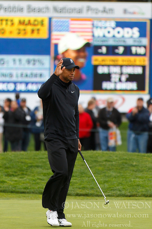 Feb 11, 2012; Pebble Beach CA, USA; Tiger Woods waves to the crowd after putting for birdie on the 15th hole during the third round of the AT&T Pebble Beach Pro-Am at Pebble Beach Golf Links. Mandatory Credit: Jason O. Watson-US PRESSWIRE