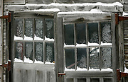 Frosty windows on snowy barn doors in Montpelier Vermont.
