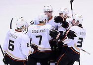 Mar. 2, 2013; Glendale, AZ, USA; Anaheim Ducks defensemen Andrew Cogliano (7) celebrates with forward Matt Beleskey (39) , forward Daniel Winnik (34) , defensemen Toni Lydman (32) and defensemen Ben Lovejoy (6) after scoring against the Phoenix Coyotes in the second period at Jobing.com Arena. Mandatory Credit: Jennifer Stewart-USA TODAY Sports