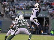 Dec 24, 2017; East Rutherford, NJ, USA; Los Angeles Chargers wide receiver Keenan Allen (13) catches a pass as New York Jets free safety Marcus Maye (26) and strong safety Jamal Adams (33) defend during an NFL football game at MetLife Stadium. The Chargers defeated the Jets 14-7.