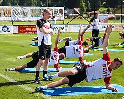 02.07.2013, Dana Arena Windischgarsten, WIndischgarsten, AUT, GER 2. FBL, Trainingslager 1. FC Koeln, im Bild Peter Stoeger, (1. FC Koeln, Trainer) beobachtet Kevin Wimmer, (1. FC Koeln, #28) beim Aufwaermen // during the training Camp of the German Bundesliga Club 1. FC Koeln at the Dana Arena Windischgarsten, Windischgarsten, Austria on 2013/07/02. EXPA Pictures © 2013, PhotoCredit: EXPA/ Roland Hackl