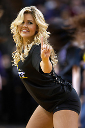 March 14, 2011; Sacramento, CA, USA;  A member of the Sacramento Kings dance team performs during the second quarter against the Golden State Warriors at the Power Balance Pavilion. Sacramento defeated Golden State 129-119.