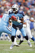 NASHVILLE, TN - DECEMBER 3:  Rookie quarterback Vince Young #10 of the Tennessee Titans is about to hand off the ball on a running play while completing 15 of 25 passes for 163 yards and two touchdowns to go with his 78 yards rushing against the Indianapolis Colts at LP Field on December 3, 2006 in Nashville, Tennessee. The Titans defeated the Colts 20-17. ©Paul Anthony Spinelli *** Local Caption *** Vince Young