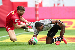 March 9, 2019 - Vancouver, BC, U.S. - VANCOUVER, BC - MARCH 09:  Isaac Kaay (8)  of Canada grapples with during Aminiasi Tuimaba (11)  of Fiji as he scores a try on day 1 of the 2019 Canada Sevens Rugby Tournament on March 9, 2019 at BC Place in Vancouver, British Columbia, Canada. (Photo by Devin Manky/Icon Sportswire) (Credit Image: © Devin Manky/Icon SMI via ZUMA Press)