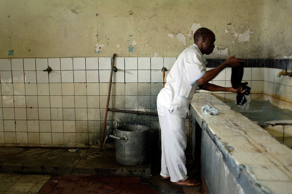 Kinshasa November 30, 2005 - Kinshasa General Hospital, a man in the washery .The Kinshasa General Hospital, is far from being a bush dispensary. With its 2,000 beds and its 2,250 employees (doctors, nurses and administrative personnel), it is one of Africa's most impressive medical facilities. It offers a full range of services and is the undisputed referral centre for the Congolese capital. Its patients the sick, accident victims and war casualties, both civilian and military  have one thing in common: their suffering, which the staff do their best to alleviate with the means available. But those means are often woefully inadequate