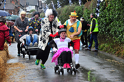 &copy; Licensed to London News Pictures.01/01/2018<br /> SUTTON VALENCE, UK.<br /> MICKEY MOUSE TEAM AT THE START.  FINISHED 4TH.<br /> The traditional New Years day Sutton Valence Pram Race in Kent continued this year. In its 38th year the Race was struck by tragedy last year when competitor Francis 'Titch' O' Sullivan tipped over in his spitfire pram and hit his head on the curb, he passed away a day later. A coroners court reported he was not wearing a helmet.<br />  All babies in the pram's have to wear a helmet and the pushers must have contact with the pram and the ground at all times.<br />  <br /> Photo credit: Grant Falvey/LNP