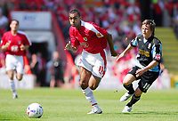 Photo: Leigh Quinnell.<br /> Bristol City v Rotherham United. Coca Cola League 1. 05/05/2007. Bristol Citys Kevin Betsy gets away from Rotherhams Stephen Brogan.