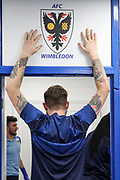 AFC Wimbledon midfielder Anthony Wordsworth (40) with hands on club crest during the EFL Sky Bet League 1 match between AFC Wimbledon and Peterborough United at the Cherry Red Records Stadium, Kingston, England on 18 January 2020.