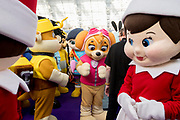 UNITED KINGDOM, London: 22 January 2019. Children's character's in costume are given directions for a picture at The Toy Fair 2019 being held at Olympia London this morning. The Toy Fair, which runs between 22nd-24th of January, is the UK's largest toy trade event with over 250 exhibiting companies launching thousands of new products. <br /> Rick Findler / Story Picture Agency