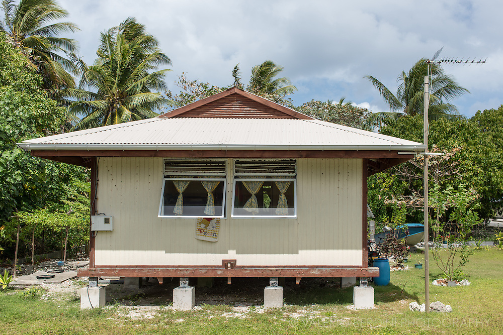 A prefabricated house on the island of Tiputa. The lack of building materials in Polynesia duplicates the costs of constructions due to the necessity of importing every material. Families often do not have other chance than building their house with cheap materials.