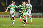 Forest Green Rovers Charlie Cooper(15) and Yeovil Town's Otis Khan(7) challenge for the ball during the EFL Trophy 3rd round match between Yeovil Town and Forest Green Rovers at Huish Park, Yeovil, England on 9 January 2018. Photo by Shane Healey.