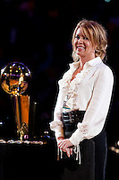 27 October 2009: Executive Vice President of the Los Angeles Lakers Jeanie Buss smiles next to the Larry O'Brien NBA championship trophy during the Los Angeles Lakers ring ceremony before the Lakers 99-92 victory over the LosAngeles Clippers at the STAPLES Center in Los Angeles, CA.