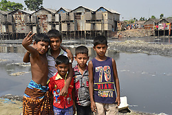 October 23, 2016 - Dhaka, Bangladesh - A group of Bangladeshi slum children are enjoying at Rayer Bazar slum in Dhaka city, Bangladesh on October 23, 2016...Bangladeshi slum child at Rayer Bazar slum in Dhaka. More than half of the populations of city slums are children. They face hardship on a daily basis that includes hunger, poor access to clean water, health care, insufficient education and protection. (Credit Image: © Str/NurPhoto via ZUMA Press)