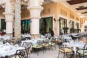 DUBAI, UAE - DECEMBER 18, 2015: The outdoor seating area at the Arboretum restaurant, located in Jumeirah Al Qasr, Madinat Jumeirah Resort. The restaurant can accommodate up to 900 guests.