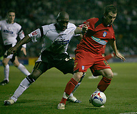 Jamie Cureton (front) tries to shield the ball from Darren Moore (back)