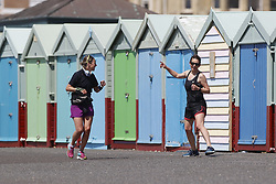 © Licensed to London News Pictures. 23/05/2020. Brighton, UK. People walk and exercise on the sea front at Hove in West SussexThe government has announced a series of measures to slowly ease lockdown, which was introduced to fight the spread of the COVID-19 strain of coronavirus. Photo credit: Peter Macdiarmid/LNP