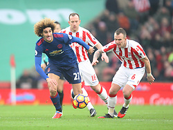 Marouane Fellaini of Manchester United (L) and Glenn Whelan of Stoke City in action - Mandatory by-line: Jack Phillips/JMP - 21/01/2017 - FOOTBALL - Bet365 Stadium - Stoke-on-Trent, England - Stoke City v Manchester United - Premier League