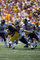 Virginia running back Josh Zidenberg (25) tackels Wyoming wide receiver Hoost Marsh (6) on a punt return.  The Wyoming Cowboys defeated the Virginia Cavaliers 23-3 at War Memorial Stadium in Laramie, WY on September 1, 2007.