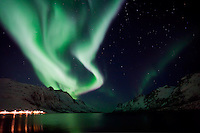 The Aurora Borealis (Northern Lights) at Ersfjordbotn village in Tromso, Norway.