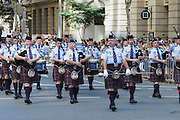 Queensland Police Pipe Band marching in 2014 ANZAC day parade - Brisbane