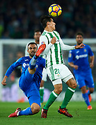 SEVILLE, SPAIN - NOVEMBER 03:  Cristian Tello of Real Betis Balompie (R) competes for the ball with Francisco Molinero of Getafe CF (L) during the La Liga match between Real Betis and Getafe at Estadio Benito Villamarin  on November 3, 2017 in Seville, .  (Photo by Aitor Alcalde Colomer/Getty Images)