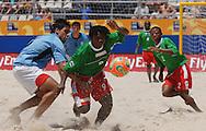 Football-FIFA Beach Soccer World Cup 2006 - Group C-CAM_URU - Medrano Tamen-CAM- is stoped by Damian-URU. - Rio de Janeiro - Brazil 06/11/2006<br />Mandatory credit: FIFA/ Marco Antonio Rezende.