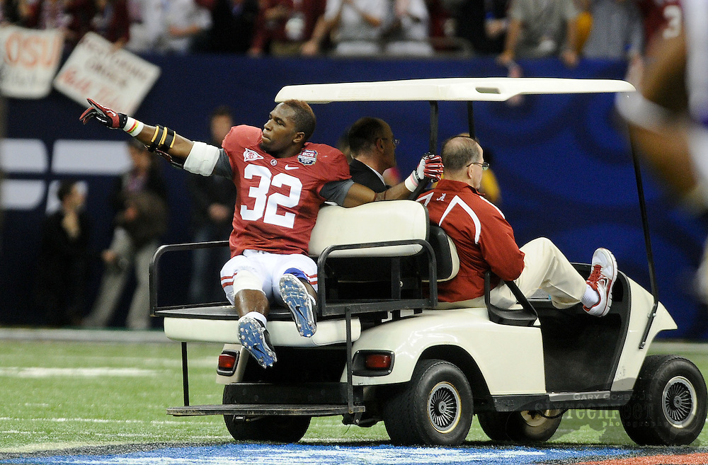 Daily Photo by Gary Cosby Jr.    ..CJ Mosley signals to the crowd after he is removed from the field with a leg injury during the second half of the BCS National Championship Game between Alabama and LSU in the Superdome Monday night...................................