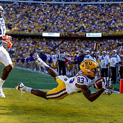 Oct 14, 2017; Baton Rouge, LA, USA; LSU Tigers wide receiver Russell Gage (83) dives for a touchdown catch past Auburn Tigers defensive back Jamel Dean (12) during the second quarter of a game at Tiger Stadium. Mandatory Credit: Derick E. Hingle-USA TODAY Sports