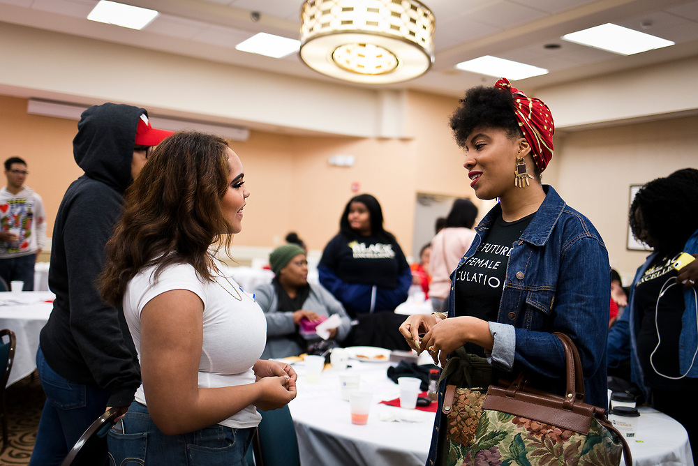 Panelist Jordan Gaines, right, speaks with students during the Black Excellence Youth Conference at the Best Western Plus Inntowner on Monday, Jan. 15, 2018.
