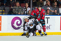 KELOWNA, CANADA - MARCH 16: Michael Farren #16 of the Kelowna Rockets checks Justin Sourdif #42 of the Vancouver Giants  on March 16, 2019 at Prospera Place in Kelowna, British Columbia, Canada.  (Photo by Marissa Baecker/Shoot the Breeze)
