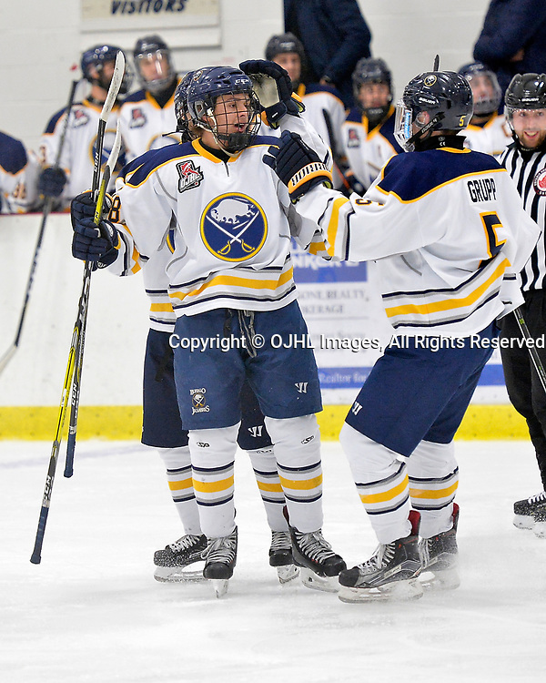 GEORGETOWN, ON  - NOV 4,  2017: Ontario Junior Hockey League game between the Georgetown Raiders and Buffalo Jr. Sabres. Matt Jakubowski #18 of the Buffalo Jr. Sabres celebrates the goal with teammates during the second period.<br /> (Photo by Shawn Muir / OJHL Images)