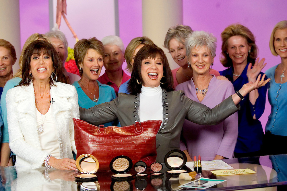 SPECIAL TO THE PALM BEACH POST---Adrienne Arpel, center, celebrates with HSN host Bobbi Ray Carter, left, at the conclusion of their broadcast on Friday, March 18, 2005 in St. Petersburg, Fla. (AP Photo/Scott Audette)