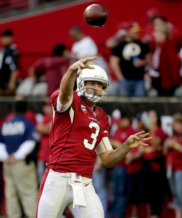 Arizona Cardinals quarterback Carson Palmer (3) warms up prior to an NFL football game against the Washington Redskins, Sunday, Dec. 4, 2016, in Glendale, Ariz. (AP Photo/Rick Scuteri)