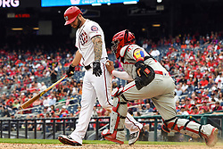 May 6, 2018 - Washington, DC, U.S. - WASHINGTON, DC - MAY 06:  Washington Nationals first baseman Matt Adams (15) is tagged out after a fouled third strike by Philadelphia Phillies catcher Jorge Alfaro (38) during the game between the Philadelphia Phillies  and the Washington Nationals on May 6, 2018, at Nationals Park, in Washington D.C.  The Washington Nationals defeated the Philadelphia Phillies, 5-4.  (Photo by Mark Goldman/Icon Sportswire) (Credit Image: © Mark Goldman/Icon SMI via ZUMA Press)