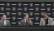 Jan 9, 2018; Alameda, CA, USA; Jon Gruden (center) is introduced as head coach flanked by owner Mark Davis (left) and general manager Reggie Mcenzie at a press conference at the Raiders headquarters.