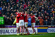 Barnsley midfielder Alex Mowatt (27) and team mates celebrate Barnsley midfielder Mike-Steven Bahre (10) scoreing a goal to make the score 2-0 during the EFL Sky Bet Championship match between Barnsley and Hull City at Oakwell, Barnsley, England on 30 November 2019.