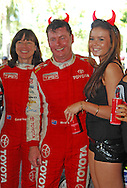 Red Devil Energy Drink Promo Girls with Neal Bates & Coral Taylor .Media Day/Shakedown.Red Devil Energy Drink Rally of Queensland.Nambour Showgrounds, Nambour, Sunshine Coast, Qld.8th of May 2009.(C) Joel Strickland Photographics.Use information: This image is intended for Editorial use only (e.g. news or commentary, print or electronic). Any commercial or promotional use requires additional clearance.