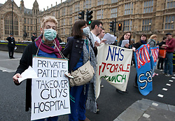 © licensed to London News Pictures. London, UK 27/02/2012. A group of NHS protesters are blocking Arbingdon Street, next to the Houses of the Parliament as they protest the government's NHS reform. Photo credit: Tolga Akmen/LNP